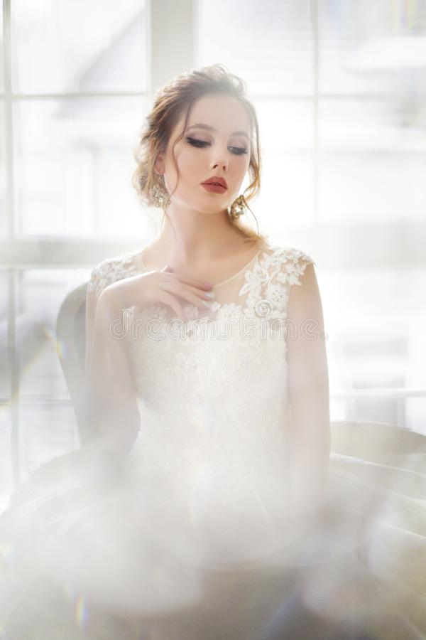 Beautiful brunette woman posing in a wedding dress stock images