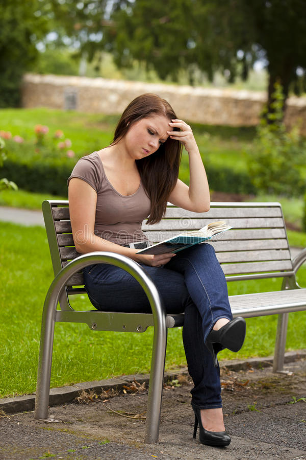 Download Beautiful Brunette Woman Reading A Book Royalty Free Stock Photo - Image: 21203905
