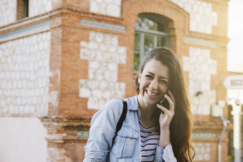 Beautiful brunette woman talking on the phone royalty free stock photography