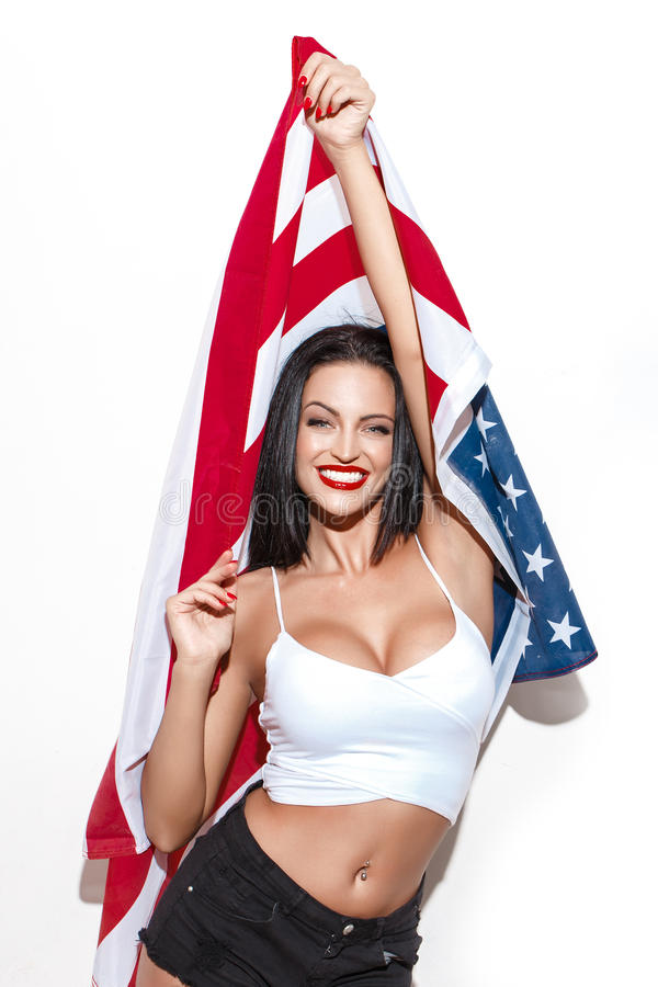 Beautiful brunette woman with usa flag. Brunette woman with usa flag, star spangled banner, independence day, 4th july stock images