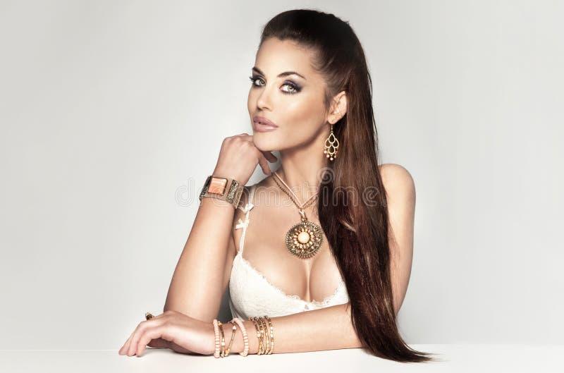 Download Beautiful Brunette Woman Wearing A Lot Of Jewelry. Stock Image - Image of bracelets, beautiful: 30424961