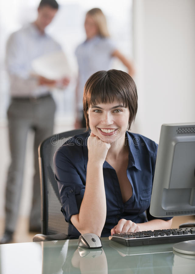 Beautiful Brunette At Work Stock Image