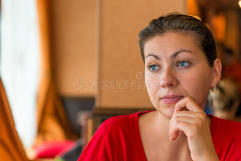 Beautiful brunette 30 years lost in thought royalty free stock images