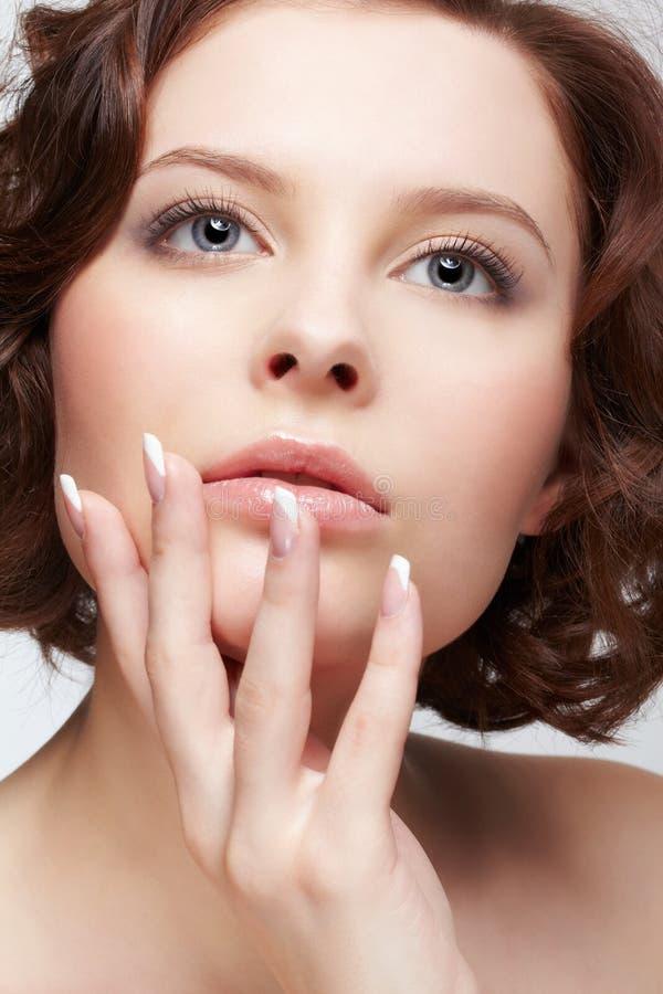 Beautiful brunette young woman stock image