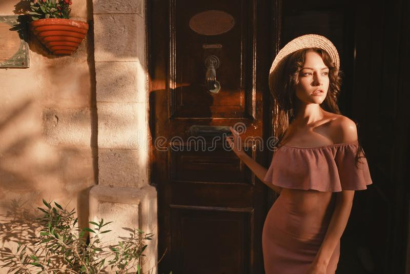 Stylish brunette woman walking in old town royalty free stock photos