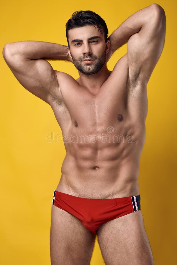 Beautiful brutal tanned muscular man wearing a red underwear stock images