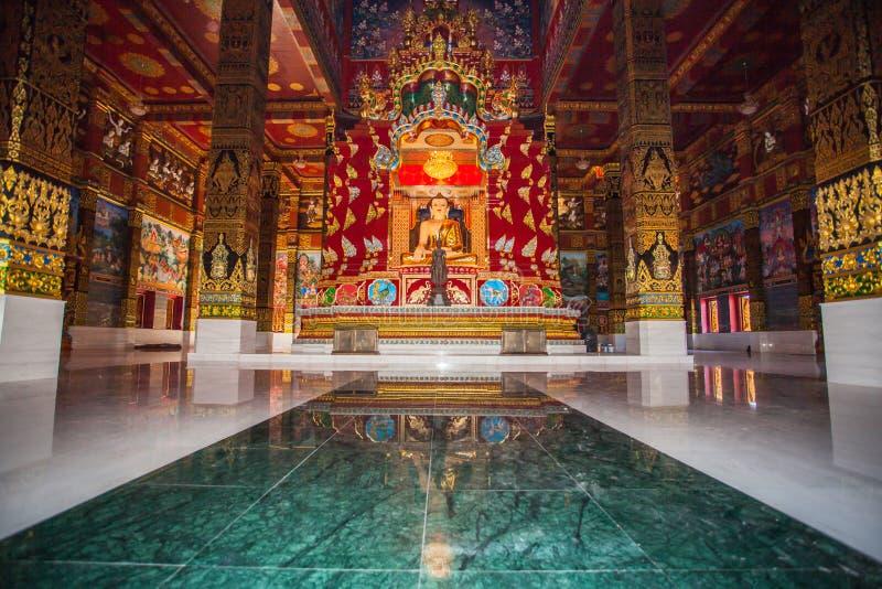 beautiful Buddha sculpture inside the high yellow pagoda royalty free stock photo