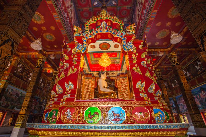 beautiful Buddha sculpture inside the high yellow pagoda stock photography
