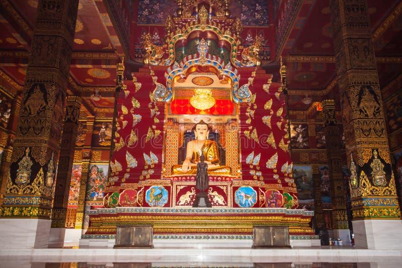 beautiful Buddha sculpture inside the high yellow pagoda in wat Bang Tong royalty free stock photography
