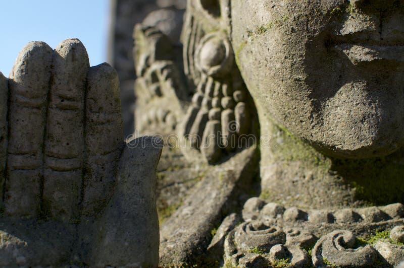 Beautiful buddha stone statue detail royalty free stock photo