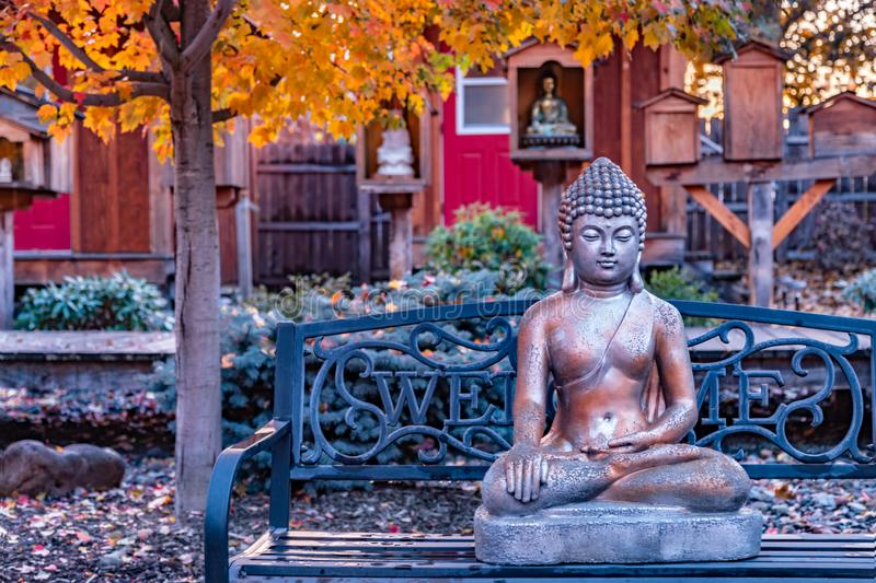 Beautiful Buddhist garden with statue of Buddha with Bhumisparsa mudra Calling the Earth to Witness the Truth royalty free stock photo