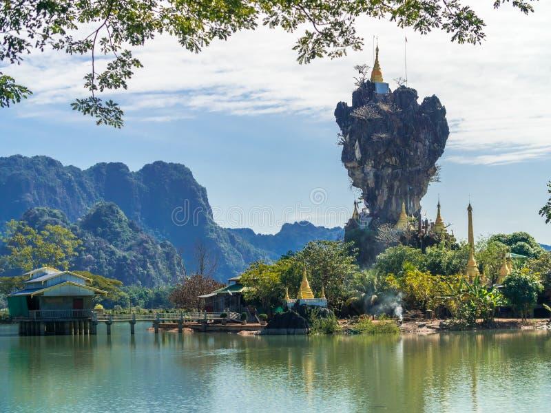 Beautiful Buddhist Kyauk Kalap Pagoda in Hpa-An, Myanmar. stock photography