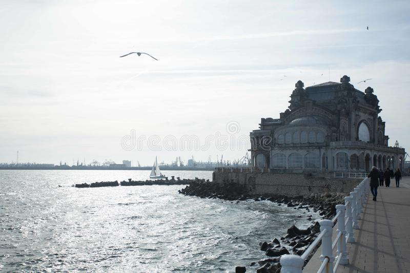 The beautiful building of the Constanta Casino in Romania. At the Black Sea, on the beautiful cliff of the port of Constanta stands majestic magnificent building stock photos