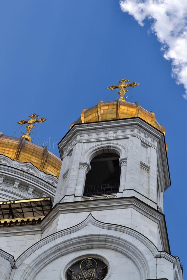 Beautiful building of the Russian Orthodox Church. Covered in gold dome. Crosses and exterior decoration. Love to God stock photo