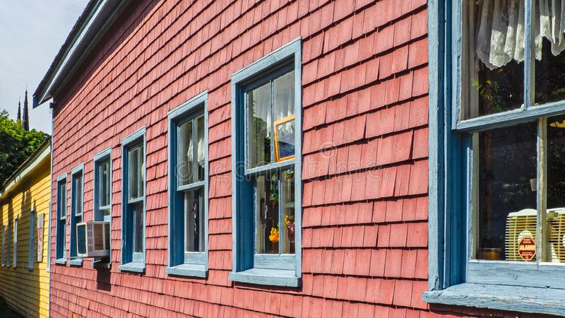 Beautiful buildings with blue windows on the colorful wall in Prince Edward Island, Canada royalty free stock photos