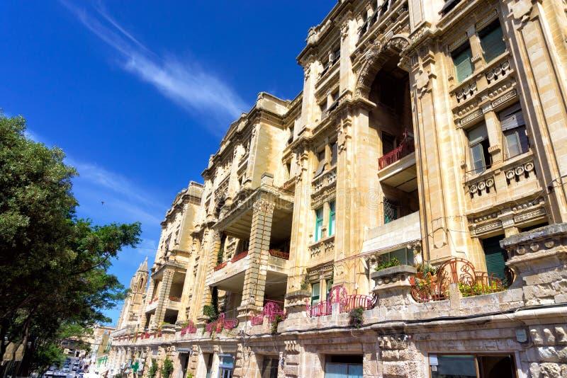 Colorful street in St Julians in Malta. Beautiful buildings lining a street in St Julians, Malta stock photo