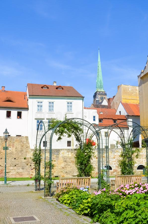Beautiful buildings in the old town of Plzen, Czech Republic with dominant Cathedral of St. Bartholomew shot from adjacent park. Pilsen, Western Bohemia royalty free stock photo