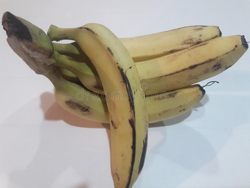 Beautiful bunch of ripe Banana. Delicious banana isolated on white background. Raw, shrimp, cartoon, heatstroke, doll, appetizing, cute, food, ripeshrimp stock photography