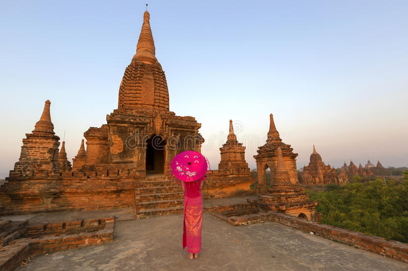 Beautiful burmese dressed lady at Bagan. Beautiful Burmese dressed lady in front of temple, Bagan royalty free stock image
