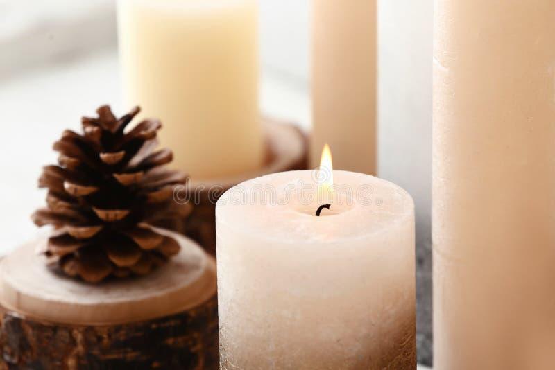 Beautiful burning candle, closeup royalty free stock photography