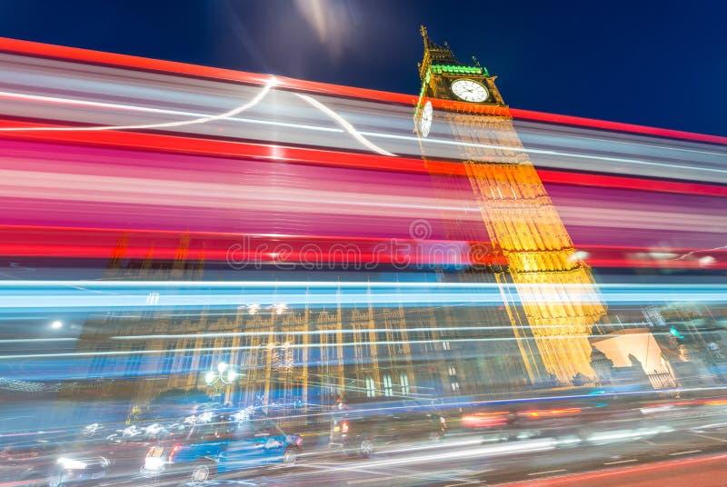Beautiful bus light trails under Big Ben, London stock image
