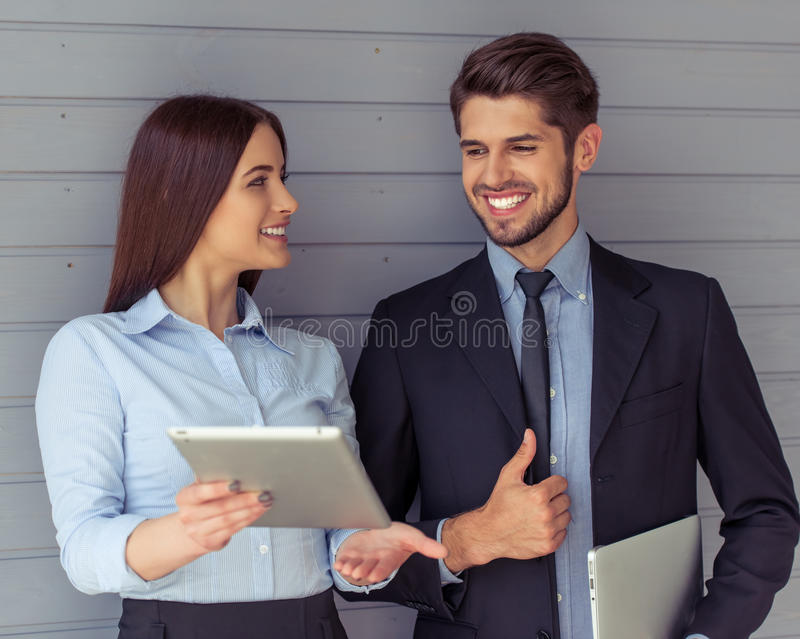 Beautiful business couple with gadget royalty free stock images