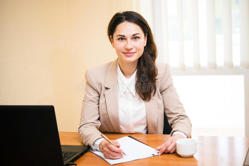 Beautiful business girl is making a business plan royalty free stock photo