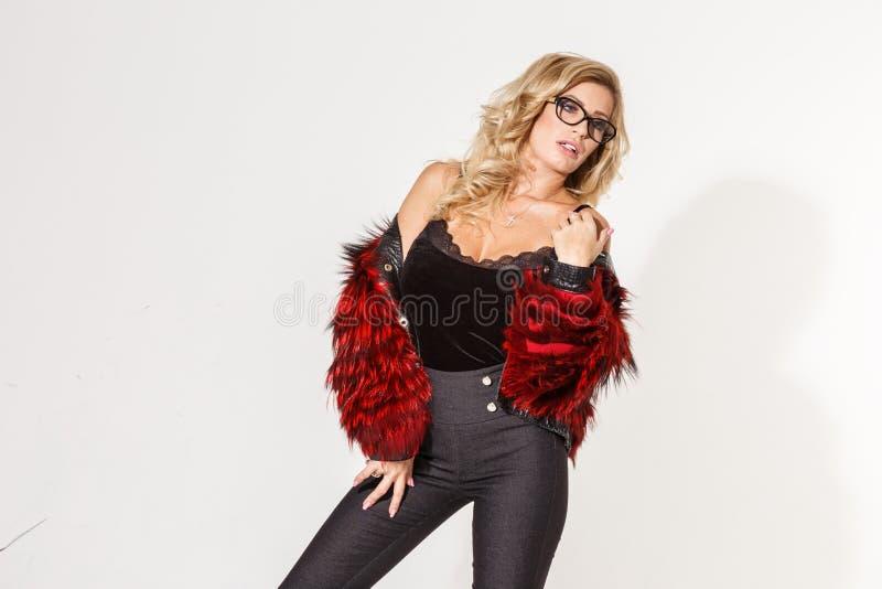 Beautiful business girl blonde elegant posing on white background royalty free stock images