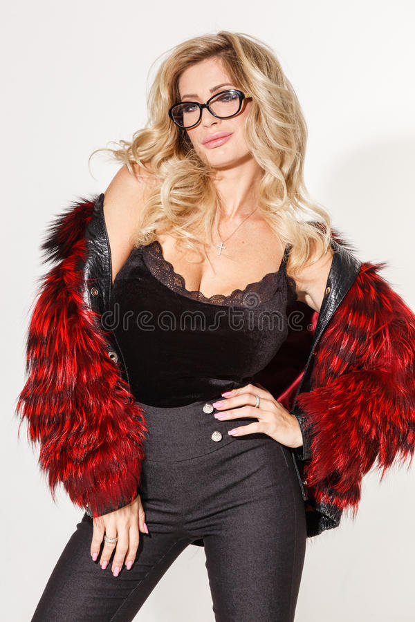 Beautiful business girl blonde elegant posing on white background stock photography