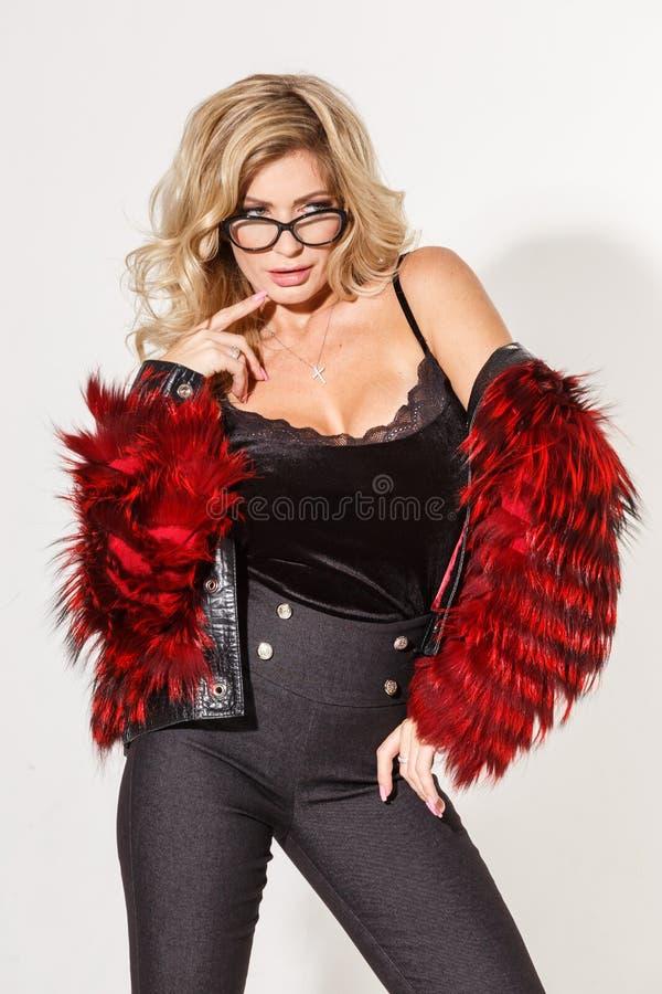 Beautiful business girl blonde elegant posing on white background stock images