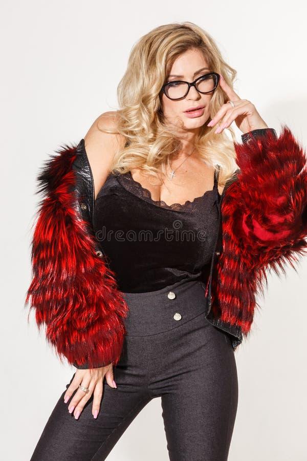 Beautiful business girl blonde elegant posing on white background royalty free stock image