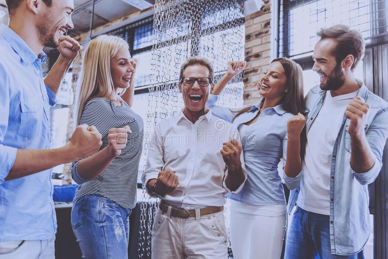 Beautiful Business Team in Casual Wear Holding Hands stock images
