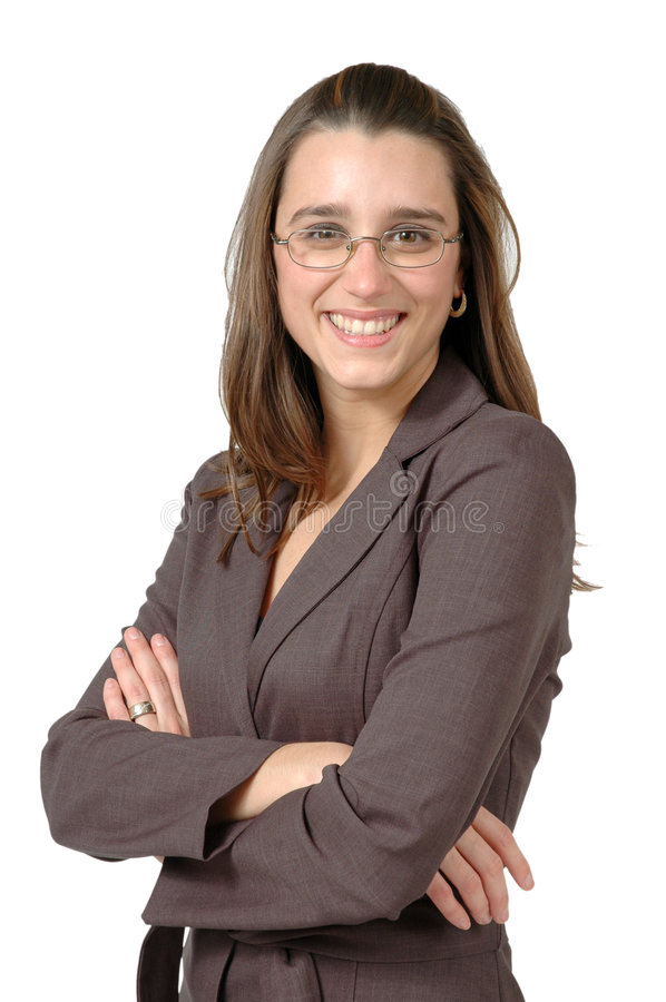 Beautiful Business Woman. Business woman with glasses crosses her arms and relaxs while smiling at you. Vertical crop on white royalty free stock photo