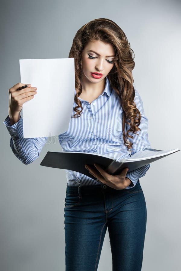 Beautiful business woman with documents royalty free stock image