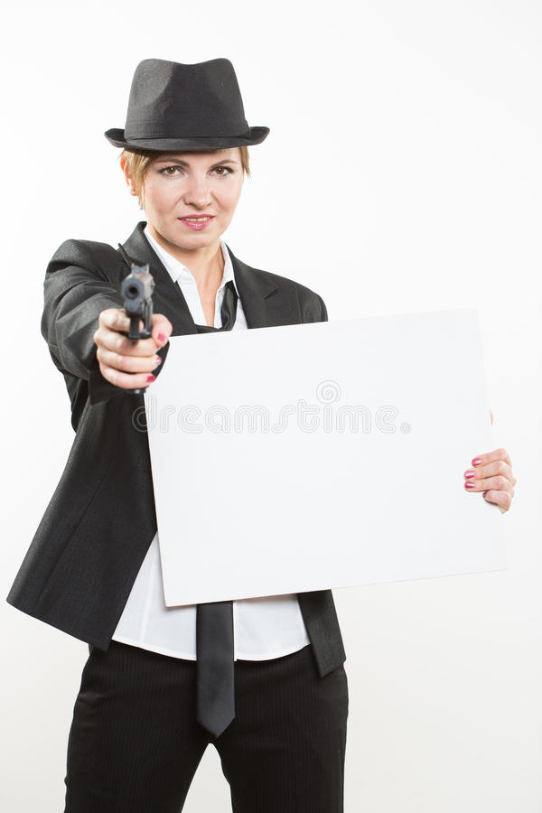 Beautiful business woman with gun olding a blank billboard. Portrait of a beautiful business woman holding a blank billboard. Ready to add text. Isolated over stock images