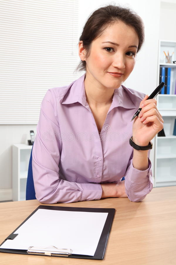 Download Beautiful Business Woman At Her Desk Thinking Stock Photo - Image: 18221472