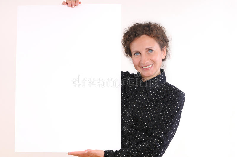 Beautiful business woman holding empty white board royalty free stock image