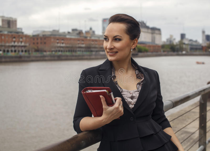 Beautiful business woman loking at the river royalty free stock photography
