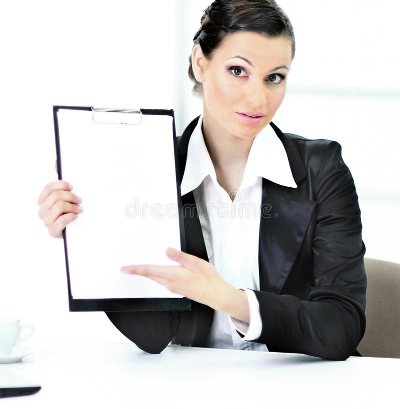 Beautiful business woman in the office, the work place with the work plan. stock photography