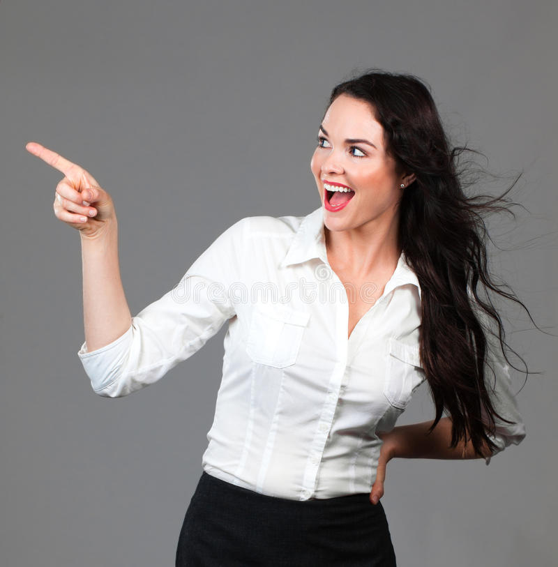 Download Beautiful Business Woman Pointing At Copyspace Stock Image - Image: 24098175