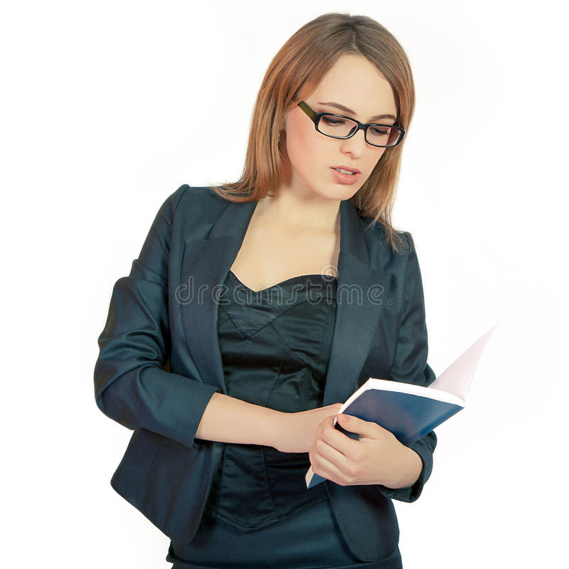 Beautiful business woman. Portraits of beautiful business woman with glasses. Holding book and pencil in hand. Caucasian woman isolated on white background stock photography