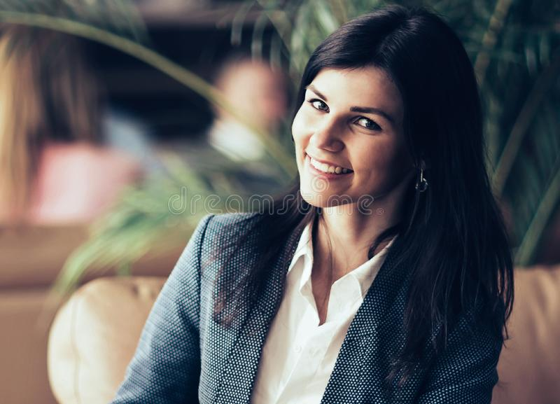 Beautiful business woman. Resting on the couch after a business royalty free stock image