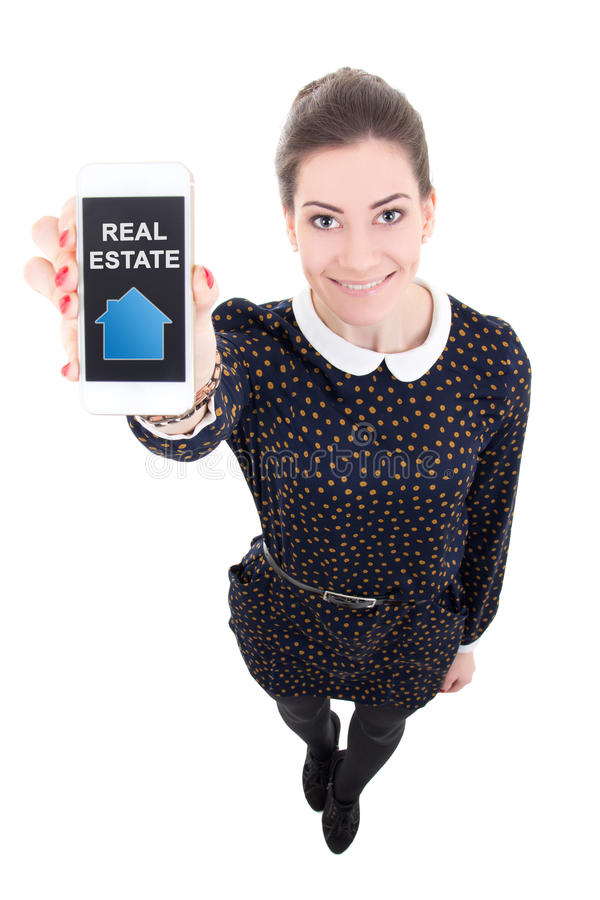 Beautiful business woman showing mobile phone with real estate a. Beautiful business woman showing mobile phone with real estatet application isolated on white stock photos