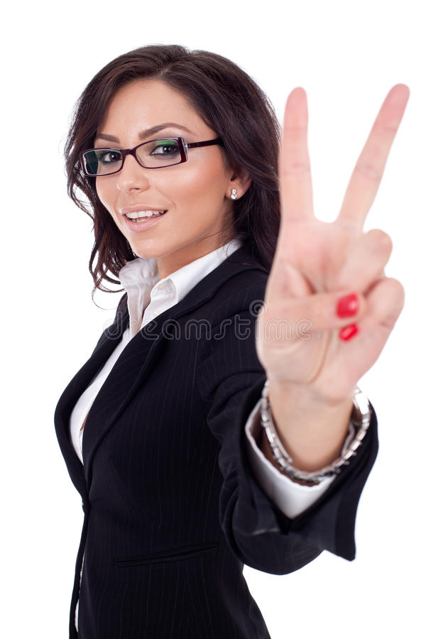 Beautiful business woman showing victory sign. Portrait of happy beautiful business woman showing victory sign, isolated stock photo