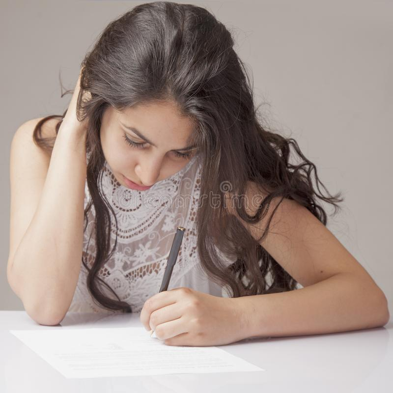 Beautiful business woman signing contract. Business, agreement,. Success, profit concept royalty free stock image