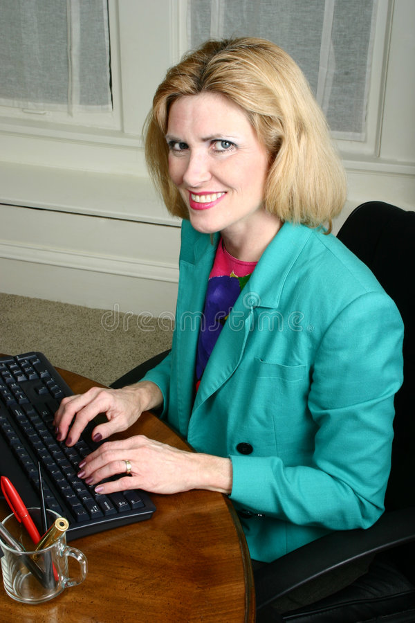 Download Beautiful Business Woman Smiling Stock Image - Image of fifties, computer: 1079691