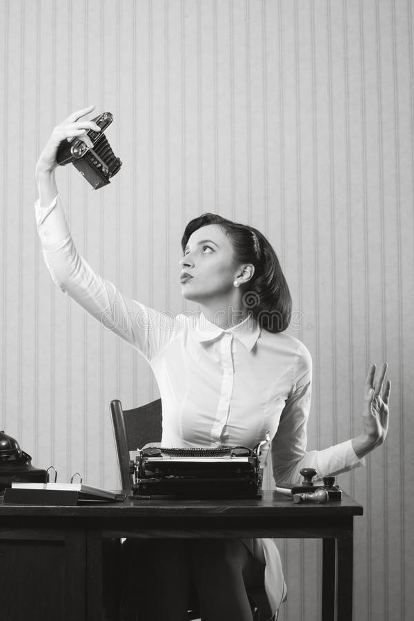 Beautiful business woman taking a picture of herself with a old royalty free stock photos