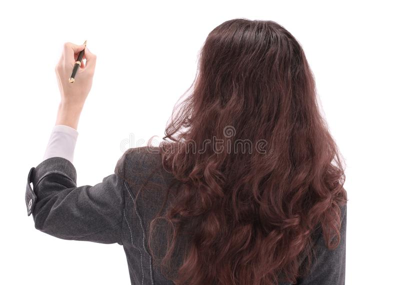 Beautiful business woman on a white background writing on the wall advertising text stock photo