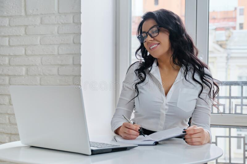 Beautiful business woman working with computer laptop royalty free stock photography