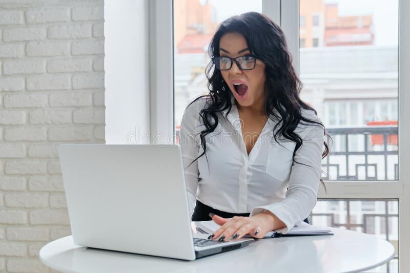 Beautiful business woman working with computer laptop stock photo
